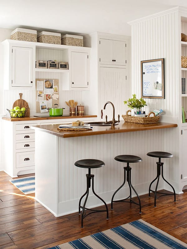 decorate over kitchen cabinets decorating above kitchen cabinets 10 ways 14529