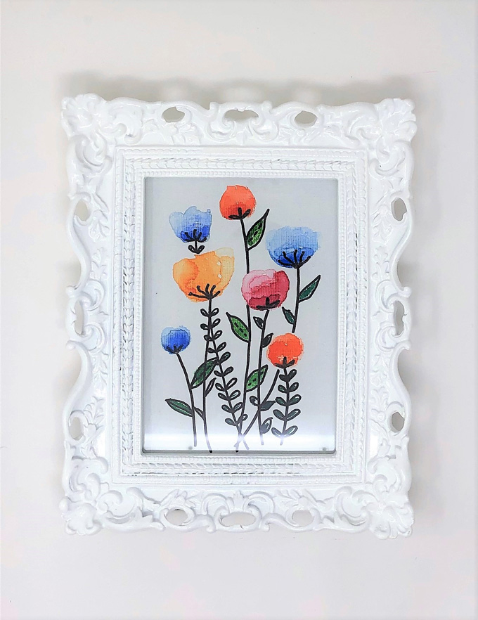 floral watercolor canvas in white frame