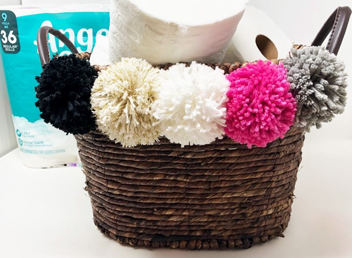 pom pom basket filled with toilet paper 2