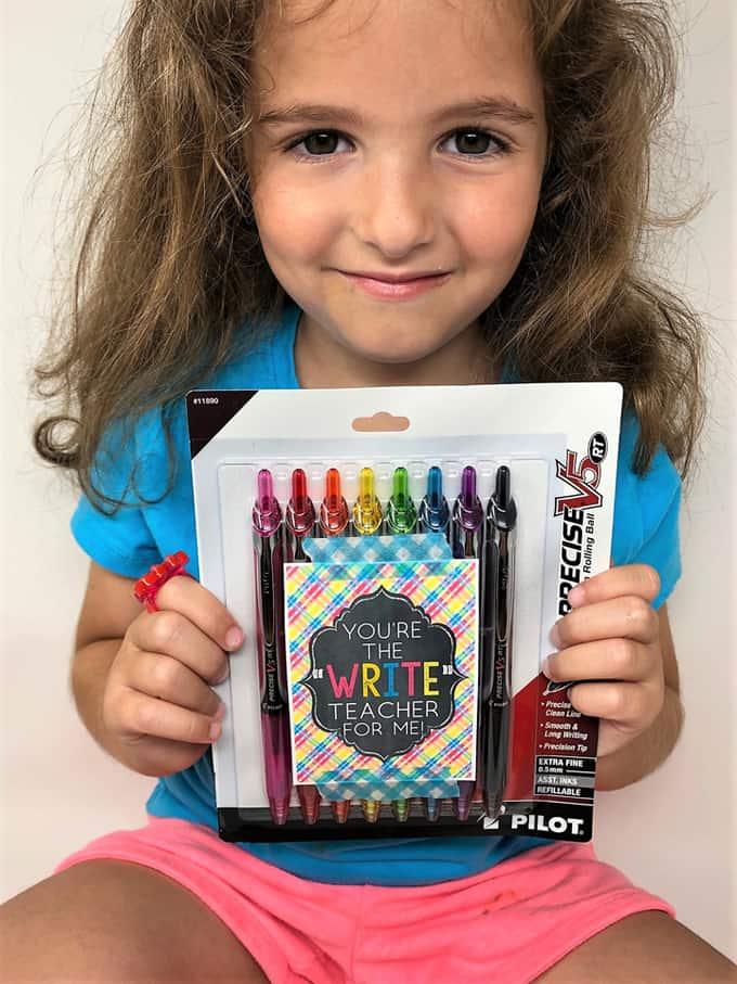 girl holding pens 2