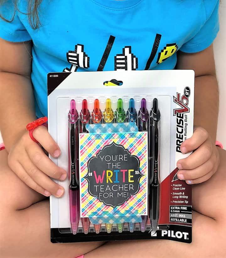 girl holding pens