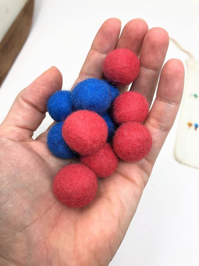 handful of wool felt balls