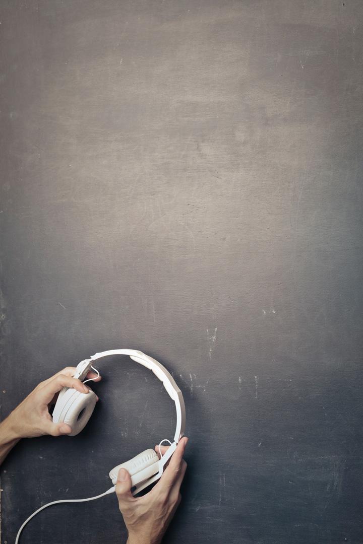 hands holding headphones